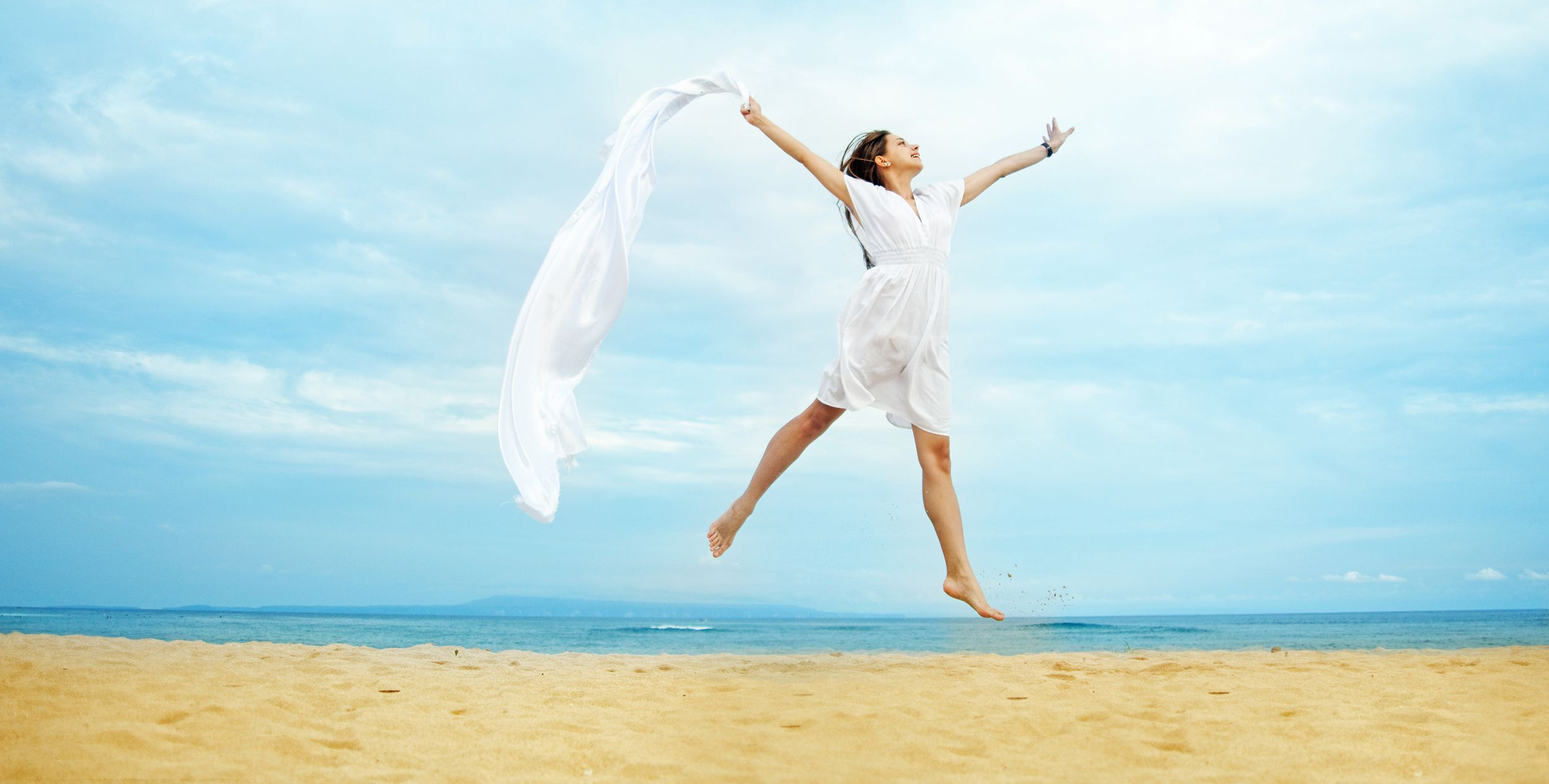 Happy Free Woman on Beach
